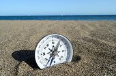 image of orientation  - Orientation Concept One Compass on the Beach near the Atlantic Ocean - JPG