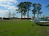 Beechcraft airplane on rural landing strip
