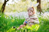 Cute Happy Little Boy Wearing Easter Bunny Ears At Spring Green Grass