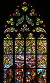 KUTNA HORA, CZECH REPUBLIC - AUGUST 23, 2014: Art Nouveau floral pattern. Stained glass window in Saint Barbara Church in Kutna Hora, Czech Republic.