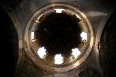 Stars transmitted through the hole in the dome of the church