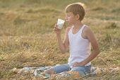 Teenage Boy With Closed Eyes Enjoys Milk
