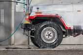 picture of water jet  - car wash with a jet of water and shampoo  - JPG