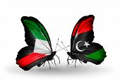 stock photo of libya  - Two butterflies with flags on wings as symbol of relations Kuwait and Libya - JPG
