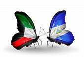 Two Butterflies With Flags On Wings As Symbol Of Relations Kuwait And Nicaragua