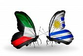 Two Butterflies With Flags On Wings As Symbol Of Relations Kuwait And Uruguay