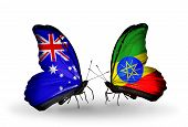 stock photo of ethiopia  - Two butterflies with flags on wings as symbol of relations Australia and Ethiopia - JPG