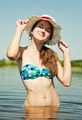 Teenage Girl Wearing Straw Hat