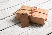 pic of wood craft  - Gift box with blank gift tag on white wooden background - JPG
