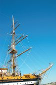 stock photo of sailing vessel  - Beautiful sailing vessel with big masts on the mooring - JPG