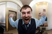 Businessman shouting at office