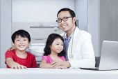 Friendly Doctor With Children