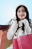Satisfied Girl Smiling With Shopping Bags