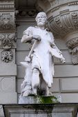 GRAZ, AUSTRIA - JANUARY 10, 2015: Statue of Industry, allegorical representation, detail of Rathaus Town Hall, Graz, Styria, Austria on January 10, 2015.