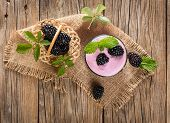 pic of blackberries  - Top view of blackberry smoothie with berries on a rustic wooden table - JPG
