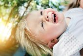 foto of rapture  - Happy and Cheerful Child in the Summer Park - JPG