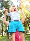 image of rapture  - Parent and Happy Child in the Summer Park - JPG