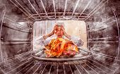 stock photo of oven  - Funny chef overlooked roast chicken in the oven - JPG