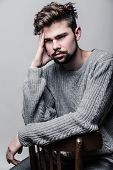 picture of pullovers  - Portrait of a young man in gray pullover - JPG