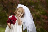 stock photo of christening  - Adorable toddler dressed as a little bride - JPG
