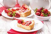 stock photo of custard  - Strawberry tart with custard on the table - JPG