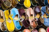 foto of flea  - Leather shoes in different colors at a flea market - JPG
