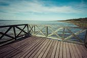 stock photo of pier a lake  - Wooden pier on big lake Lebsko in Poland - JPG
