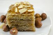 picture of baklava  - Baklava with hazelnuts on a plate close up - JPG