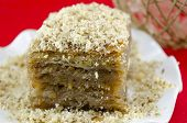 stock photo of baklava  - Baklava with grated walnuts on a plate close up - JPG