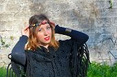 stock photo of hippy  - Hippy girl posing with colorful necklaces around her head outdoors - JPG