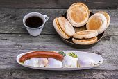 picture of benediction  - Protein rich breakfast with four eggs Benedict and Viennese sausage with toasted muffins and a cup of coffee - JPG