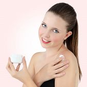 pic of body-lotion  - cheerful girl with body lotion in hand - JPG