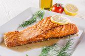 pic of salmon steak  - Salmon steak on white plate - JPG