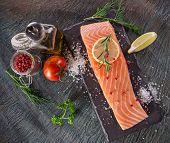 picture of salmon steak  - Delicious salmon steak on stone table - JPG