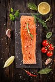 pic of salmon steak  - Delicious salmon steak on wooden table - JPG