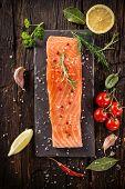 stock photo of salmon steak  - Delicious salmon steak on wooden table - JPG