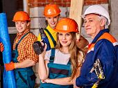 picture of millwright  - Happy group people in builder uniform looking at camera - JPG