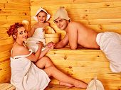 pic of sauna  - Family with one kid in hat  relaxing at sauna  - JPG