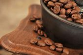 stock photo of coffee crop  - Vintage manual coffee grinder with coffee beans isolated - JPG