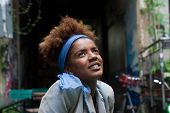 image of afro  - young happy afro woman in a urban scene - JPG