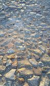 foto of paving  - Texture of road surface paved with rough stones - JPG