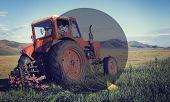 image of mongolian  - Mongolian farmer driving his tractor on the field - JPG