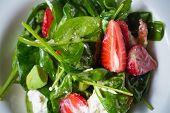 stock photo of vinegar  - Fresh Salad with strawberries - JPG