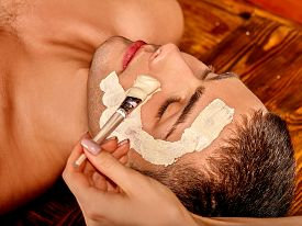 stock photo of beauty parlour  - Man getting clay facial mask in beauty spa - JPG