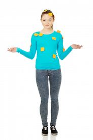 stock photo of post-teen  - Beautiful young woman covered with post it notes - JPG