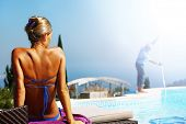 woman relaxing near swimming pool