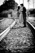 image of track home  - Young woman and World War 2 GI kissing on train tracks - JPG