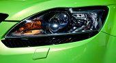 Plastic Headlight Of Green Sport Cars