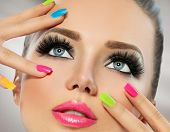 Beauty Girl Portrait with Vivid Makeup and colorful Nail polish. Colourful nails. Fashion Woman port poster