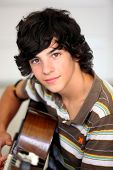 image of teenage boys  - Closeup of teenager playing the guitar - JPG